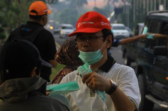 Di Pekanbaru Sinar Mas Group Bagikan 2.014 Masker